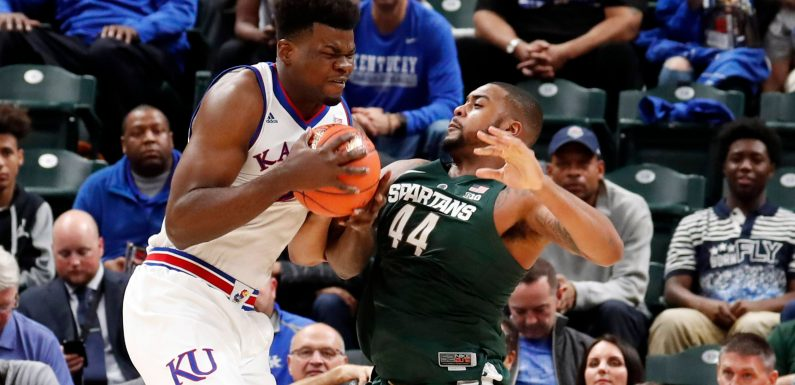 No. 1 Kansas holds off No. 10 Michigan State at Champions Classic