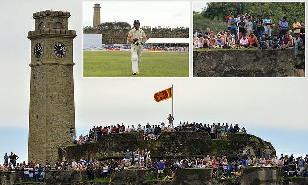 Hundreds of English and Sri Lankan cricket fans watch from Galle Fort