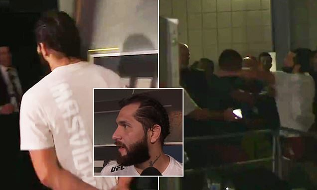 Masvidal punches Edwards moments after finishing a backstage interview