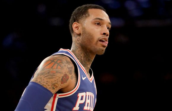 WATCH: 76ers' Mike Scott crashes into stands, takes sip of Bucks fan's drink