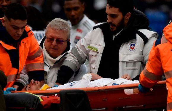 Lyon star Martin Terrier stretchered off after collapsing during Toulouse match