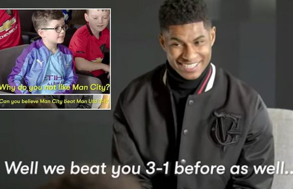 Utd star Rashford jokes about with City fan kid during an interview