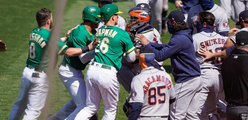 Athletics' Ramon Laureano charges Houston dugout, touching off brawl between A's and Astros
