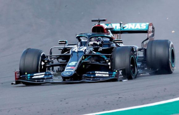Lewis Hamilton wins record seventh British Grand Prix with punctured tyre