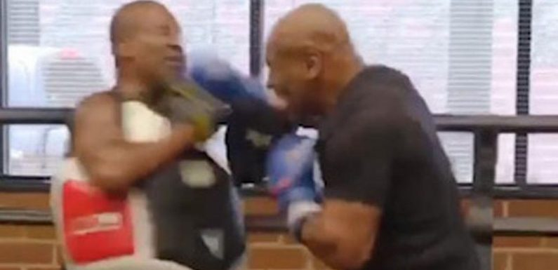 Mike Tyson nearly knocks trainer's head off showing brutal power in training