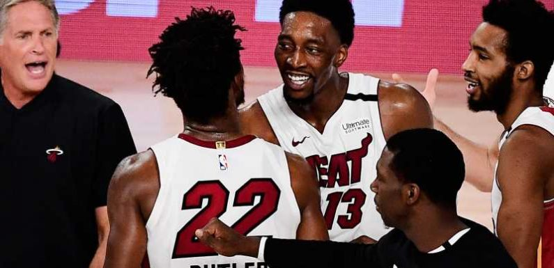 Bam Adebayo and Jimmy Butler lead Miami Heat to Game 1  overtime win over Boston Celtics