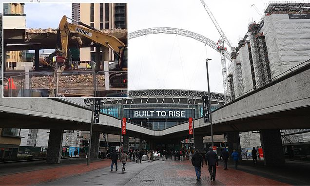 Wembley Stadium's iconic ramps are DEMOLISHED after 46 years