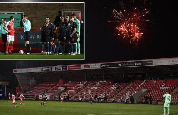 Manchester City's FA Cup match against Cheltenham stopped by FIREWORKS