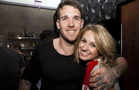 AFL great Dane Swan and partner Taylor Wilson celebrate 'surreal' birth of son