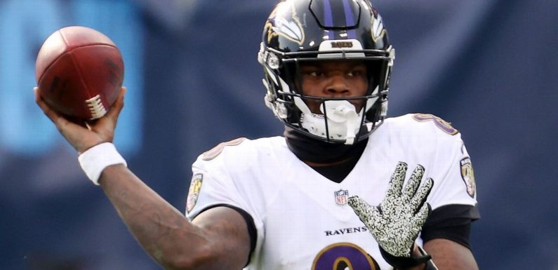 Harbaugh guarantees Lamar's fifth-year option
