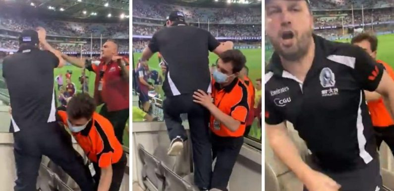 Collingwood fan charges umpires in 'super scary' scenes after Lions loss