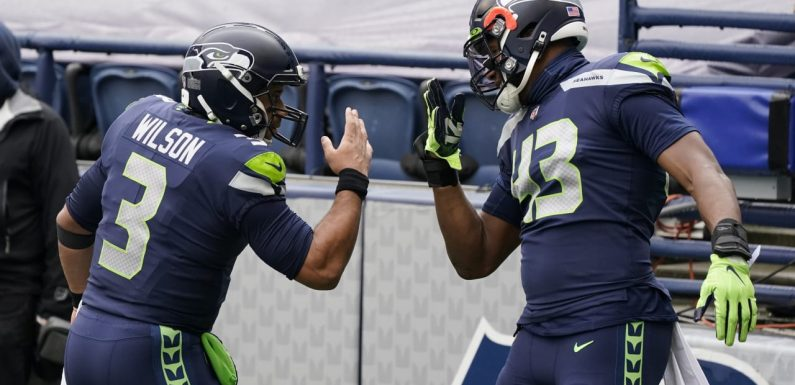 Seahawks DE Carlos Dunlap: Russell Wilson told me 'he's with us and he's here to stay'