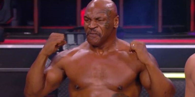 Mike Tyson showcases his power in wrestling ring while he waits for Evander Holyfield fight