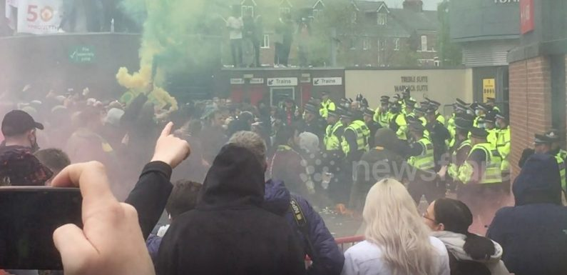 Footage emerges of Man Utd fans peppering police with bottles as officer slashed