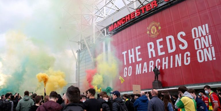 Manchester United anti-Glazer protestors break into Old Trafford and protest on pitch