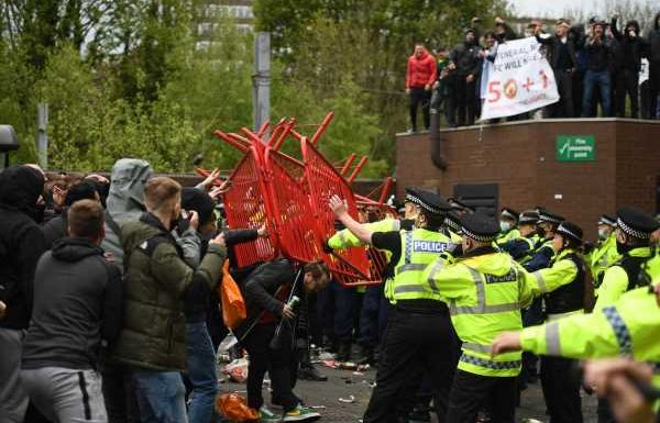 Police condemn 'reckless' Manchester United protest as two officers are injured