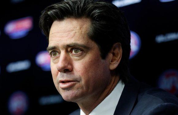 AFL chief vows to press on despite Covid scare at the MCG