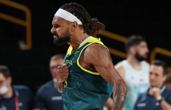 Mills carries the flag, then his nation, and leads Boomers to bronze