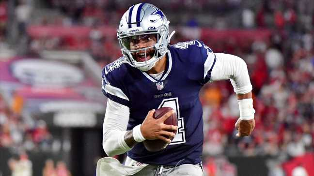Dak throws for 403 yds in 1st game in 11 months