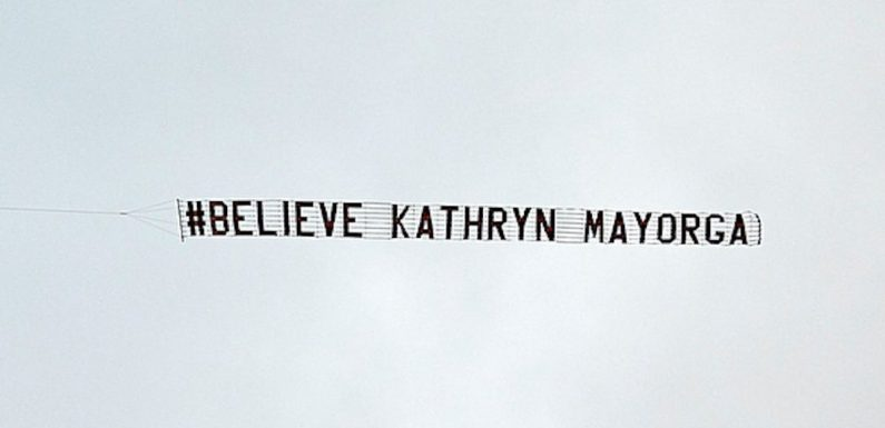 Plane with sign reading 'Believe Kathryn Mayorga' flies over Manchester United stadium