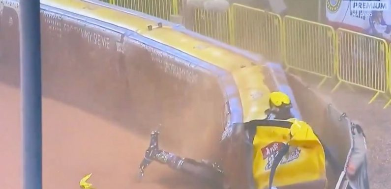 Speedway star smashes head first into wall after getting caught on handlebars