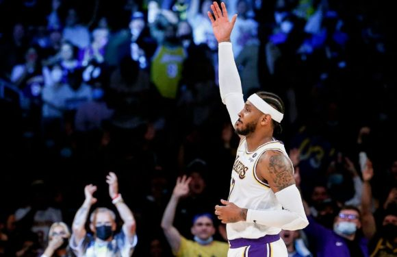 Melo's career milestone helps Lakers to first win