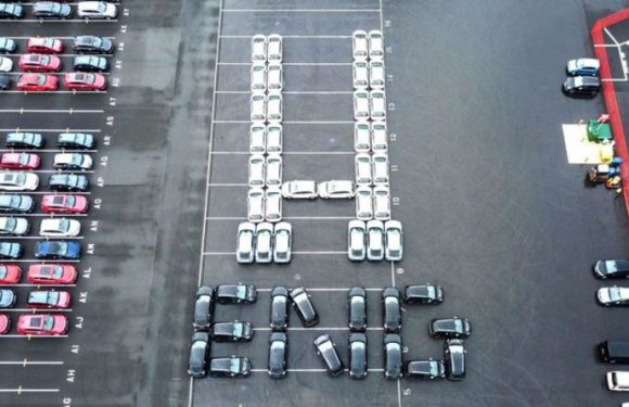 Striking aerial images show giant set of rugby posts – created using parked cars